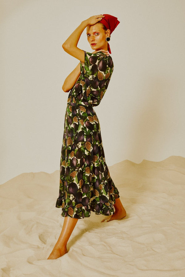 For a graceful evening statement, choose this Fig midi dress with pleats
