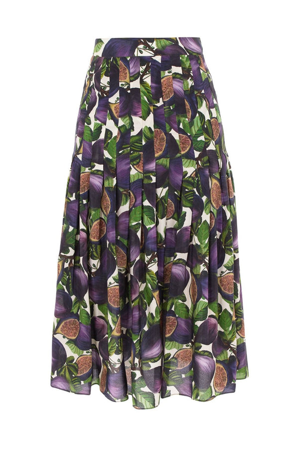 his silk skirt is precisely pleated and very chic for summer days in the city