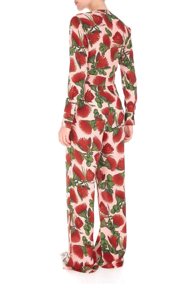 Designed to wear nonchalantly on vacation, this jumpsuit has a belt to cinch your waist and a loose silhouette that really works well with pumps or sandals