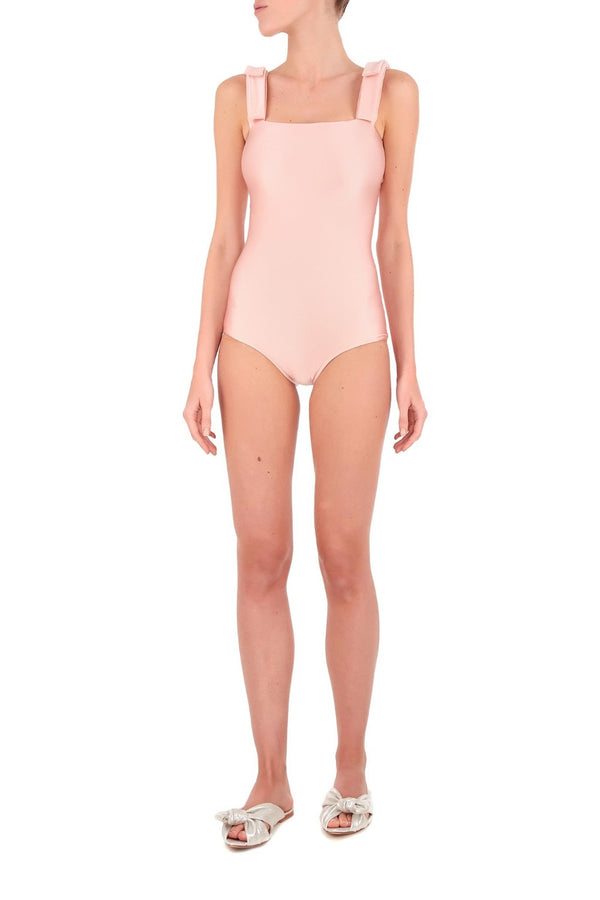 This solid and clean swimsuit is designed with square neckline that looks most flattering on athletic frames
