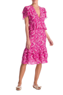 This skirt dress crafted from silk stands out for its flattering fit and  beautiful print
