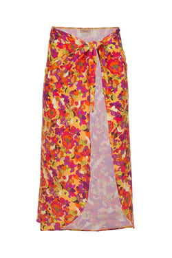 The fruit printed pareo skirt is shaped to wrap across the body and tie at the waist like a ballerina skirt
