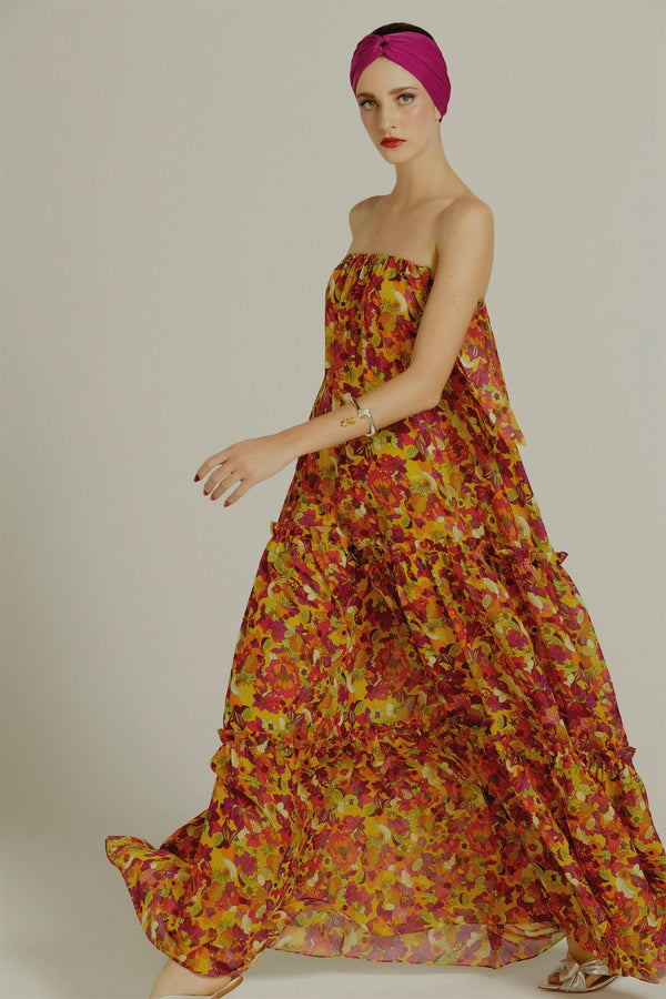 In a colorful retro print mood this maxi dress offers a refined interpretation of the designer's country, Brazil