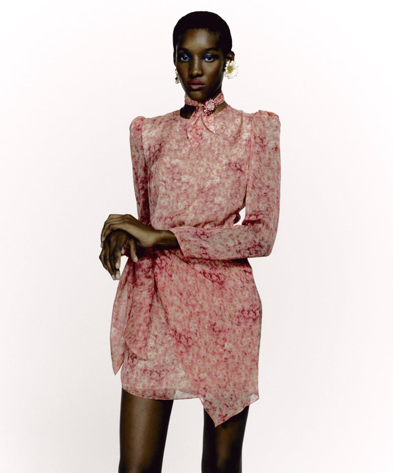 This New Vintage style dress is crafted from lightweight silk with baloon-sleeved silhouette and subtly padded shoulders