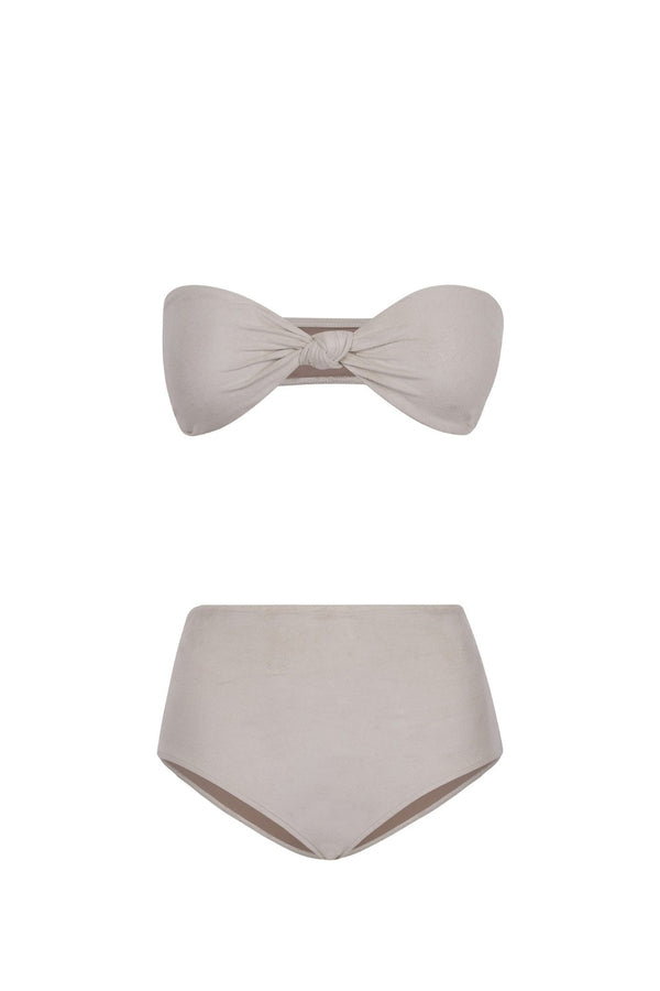 These minimalist aesthetic ivory hot pants are shaped with stretch fabric and embellished with an elegant buckle detail