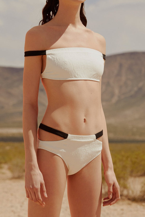This Adriana Degreas bikini is a timeless and is also a statement piece with cut-out sides and elegant colors