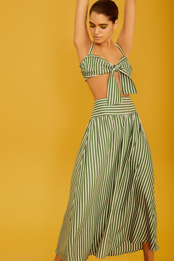 This striped top has a feminine silhouette that is shaped with a self-tie front knot and the skirt is cut for a loose fit