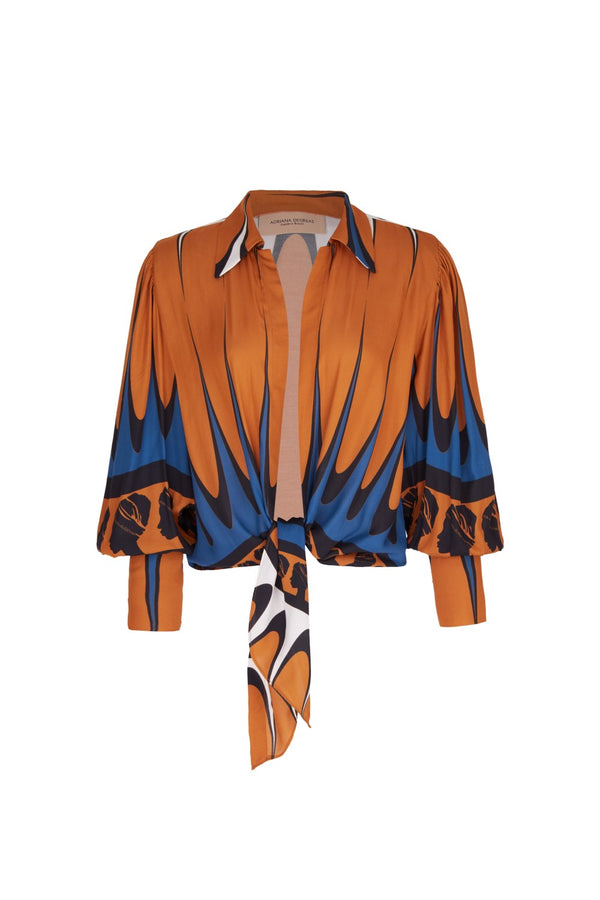 This blouse is cut from viscose and has voluminous balloon sleeves and ties at the waist