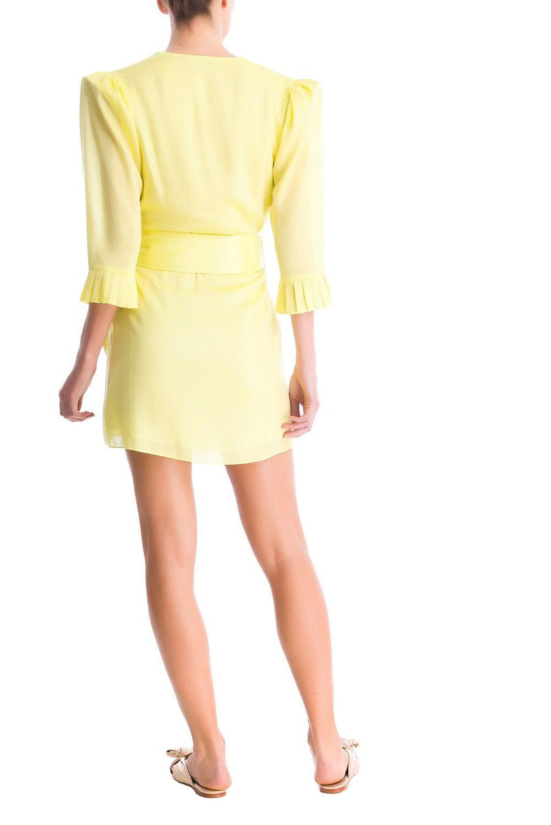 This short dress has an asymmetrical cut and shoulder pads that give an extra charm to the piece - the matching belt has an acrylic buckle detail