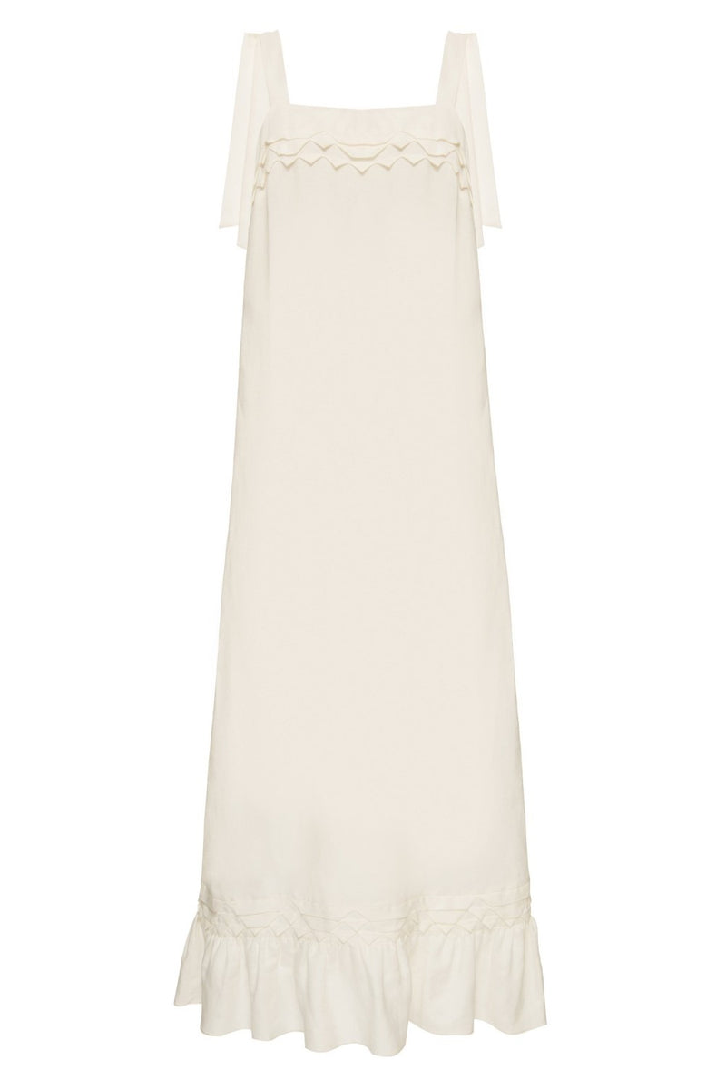 Think about effortless chic pieces to wear day and night like this long dress  with handmade details