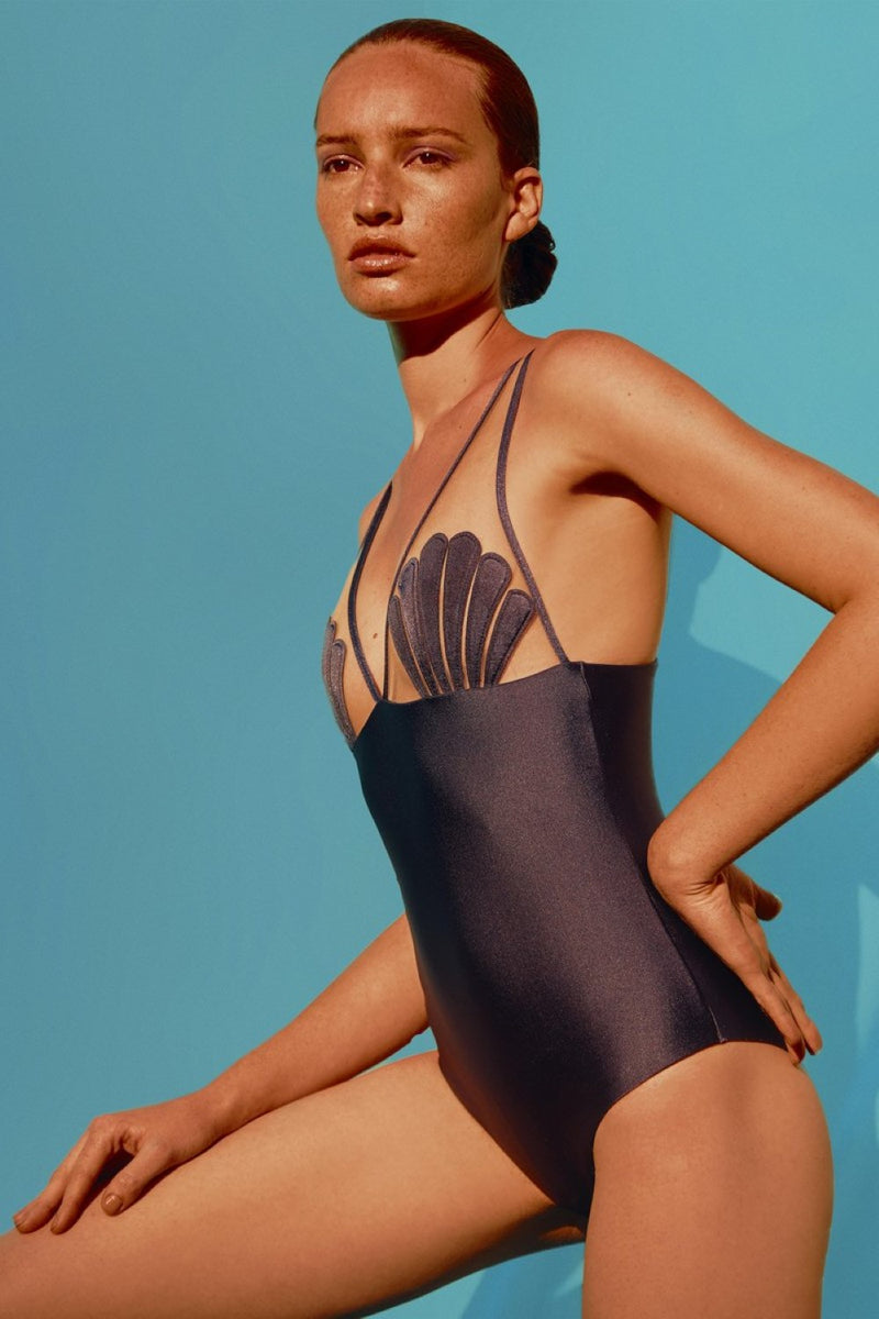 "With a modern silhouette and retro inspiration, this ""new vintage"" style swimsuit is cut from lightweight stretch fabric with beige tulle appliquéd"