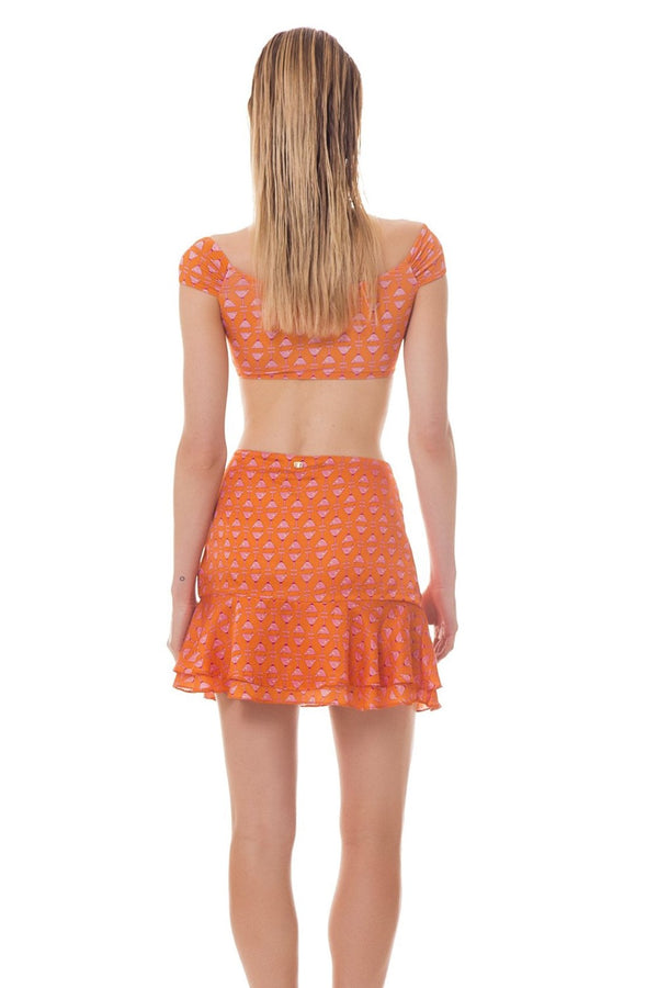his ruffled short skirt helps to complement your after-beach look in a relaxed way. All-over printed with our exclusive Martini Glass print in its orange version