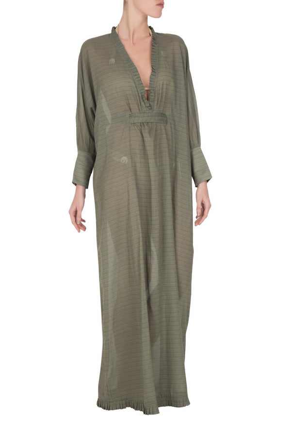 If you are looking for effortless chic dresses for your next getaway this long dress with deep V-neck that comes with the belt that cinches the loose silhouette is a nice option