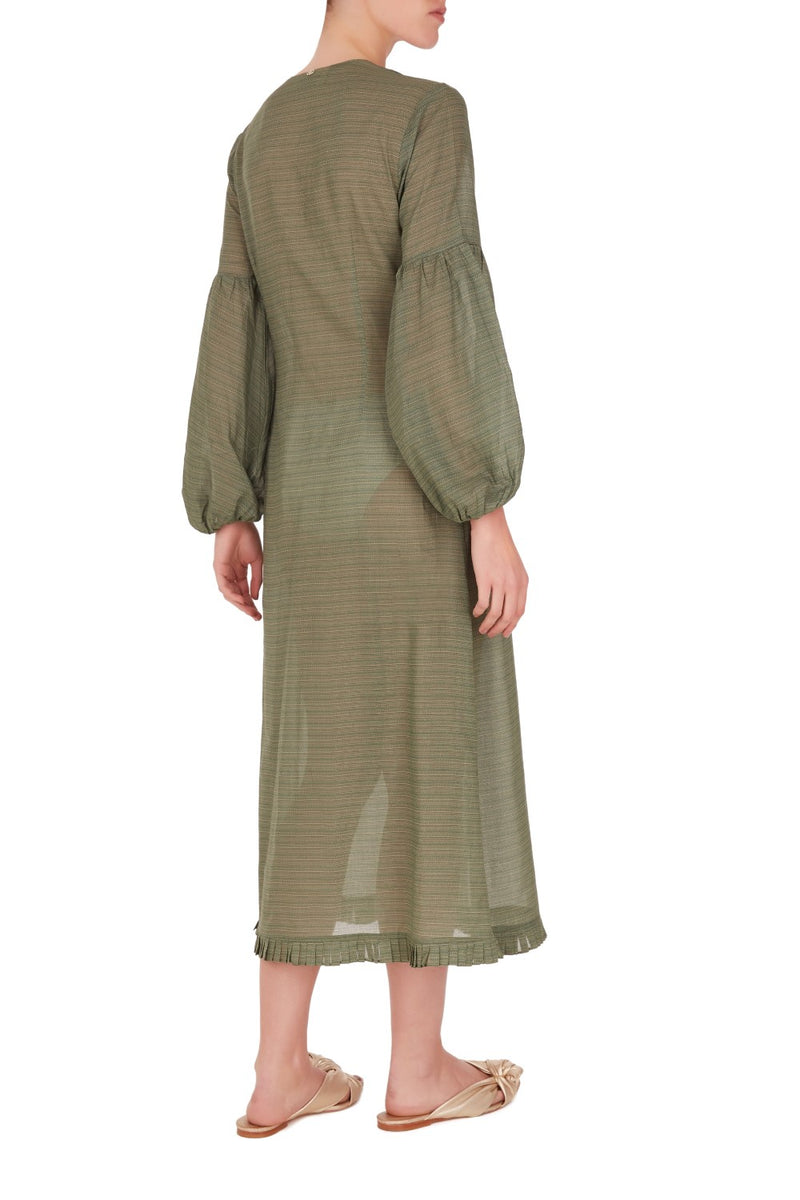 This dress can be worn as a cover up while lounging poolside or teamed with flat sandals for city walks