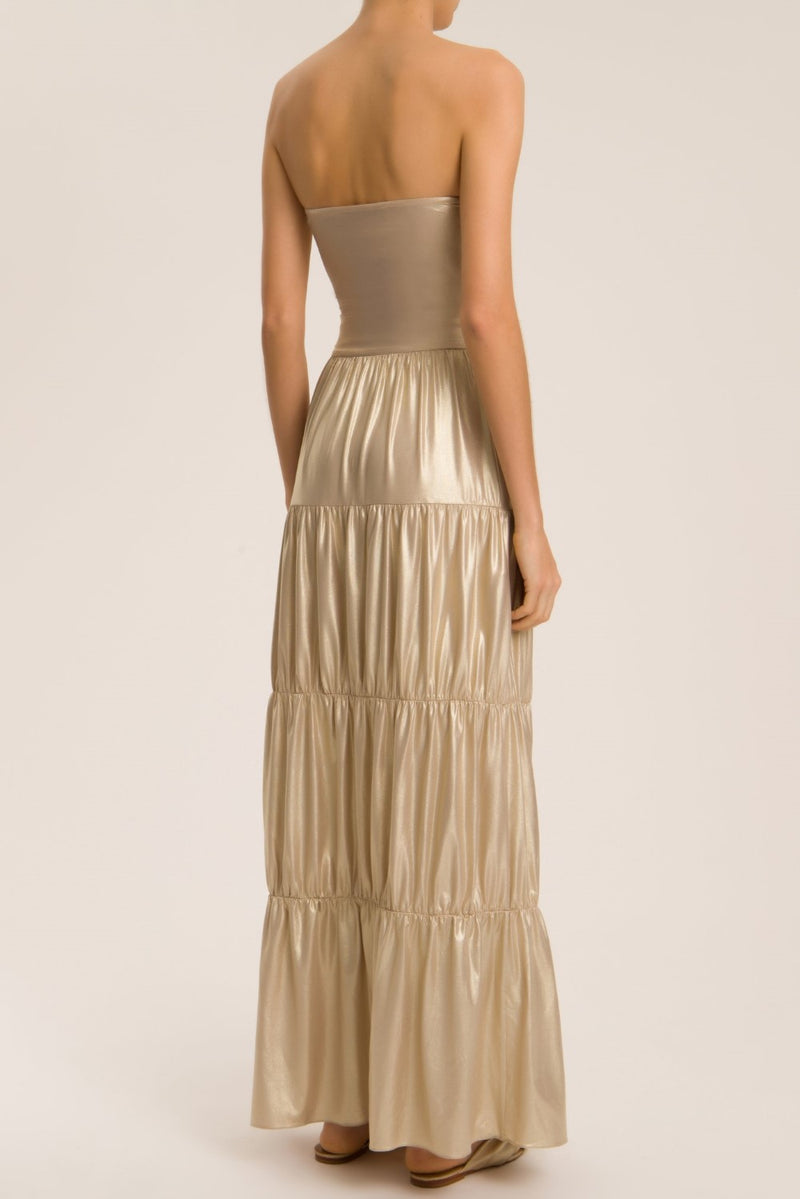 This long skirt is made of lightweight metallic fabric and can be worn in so many ways