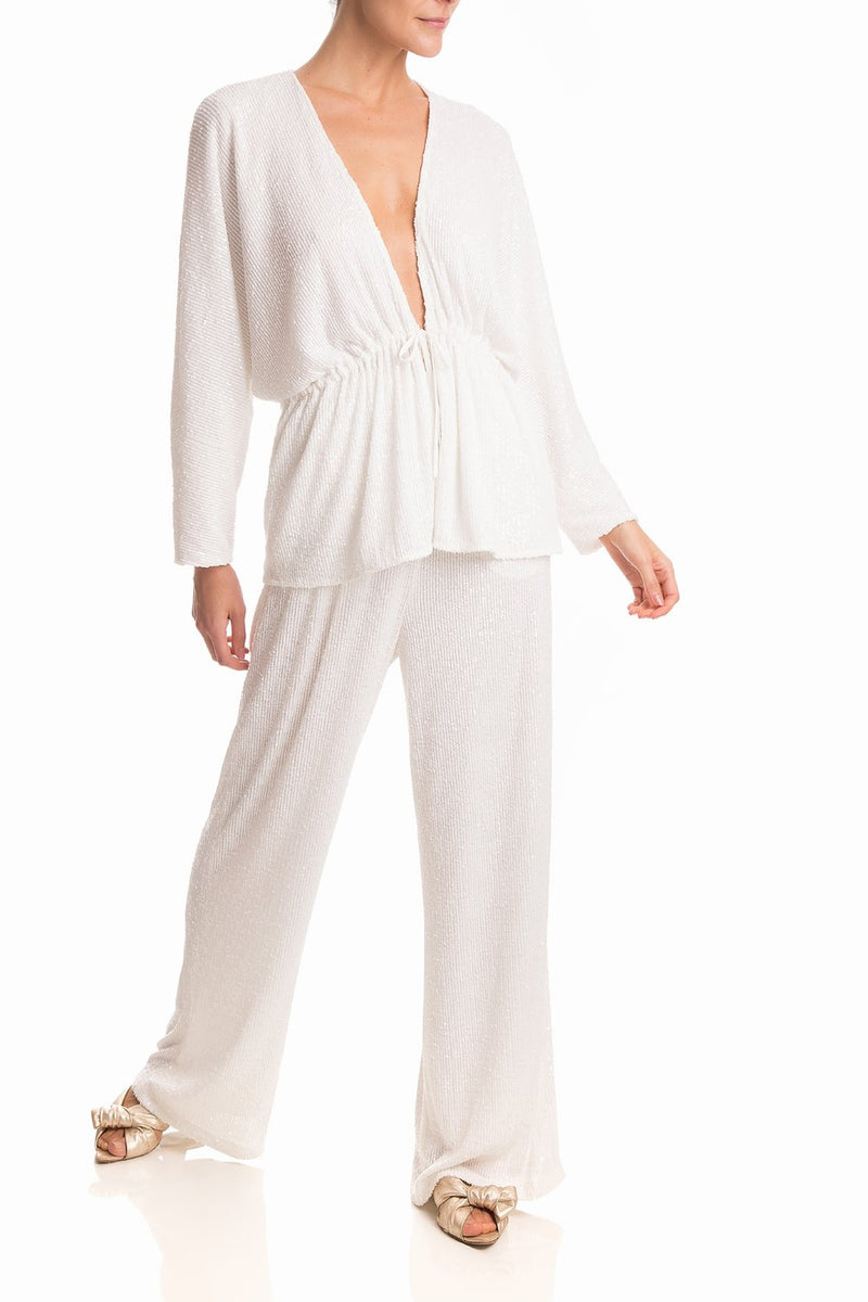 This blouse is an effortless chic style that can be worn with matching pants for an elegant event during the day with flat sandals or with naked sandals for a special dinner