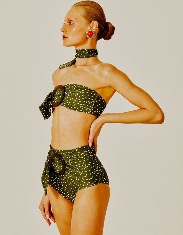 This chic belted bikini embellished with turtle resin buckle creates an elegant and feminine silhouette reminiscent from 1950s
