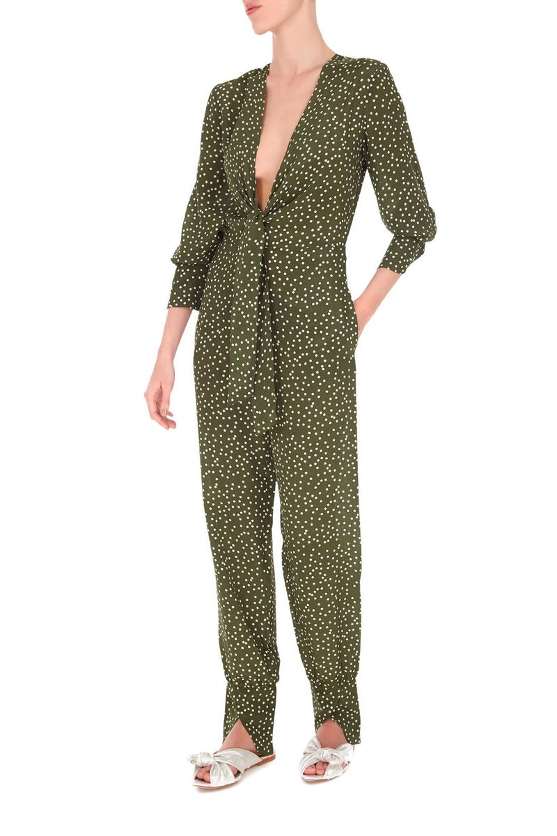 Made from lightweight silk, this comfort and modern jumpsuit is perfect for your next destination wear. Its silhouette is inspired by classic pajamas with a deep V-neck and ties at front for a summer appeal