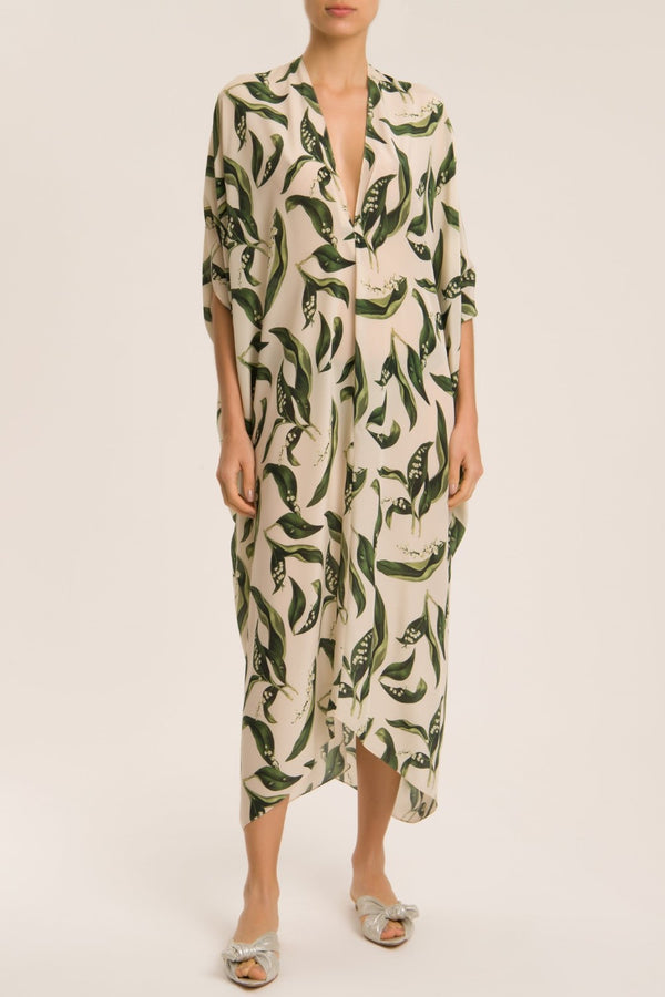 This kaftan is cut from lightweight silk so it´s perfect for slipping on over your bikini after a swim