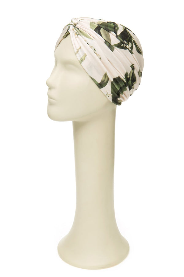 The hedaband is a vintage inspired accessorie and can be worn with a matching swimsuit poolside
