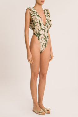 This new vintage style swimsuit- retro reference with modern appeal- features a deep v neck and matching belt