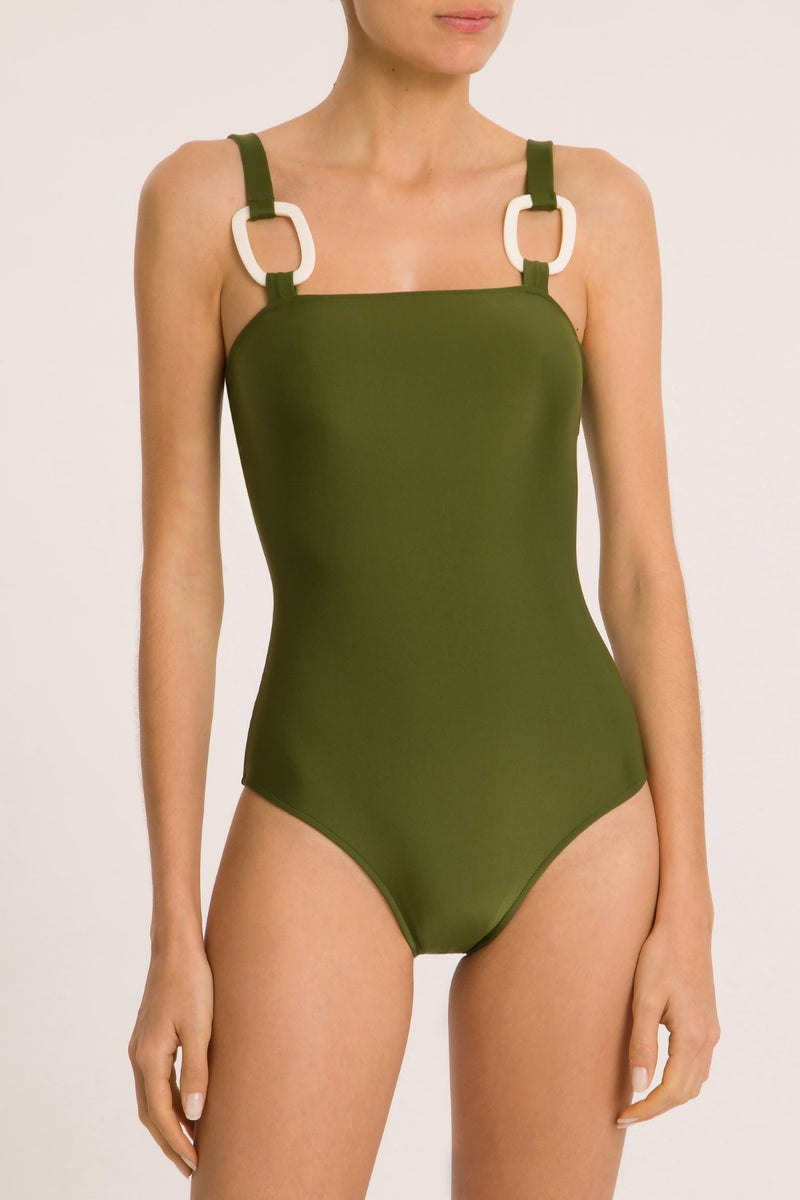 This modern meets vintage style swimsuit is made in brazil abd crafted from  stretch fabric with acrylic buckle details