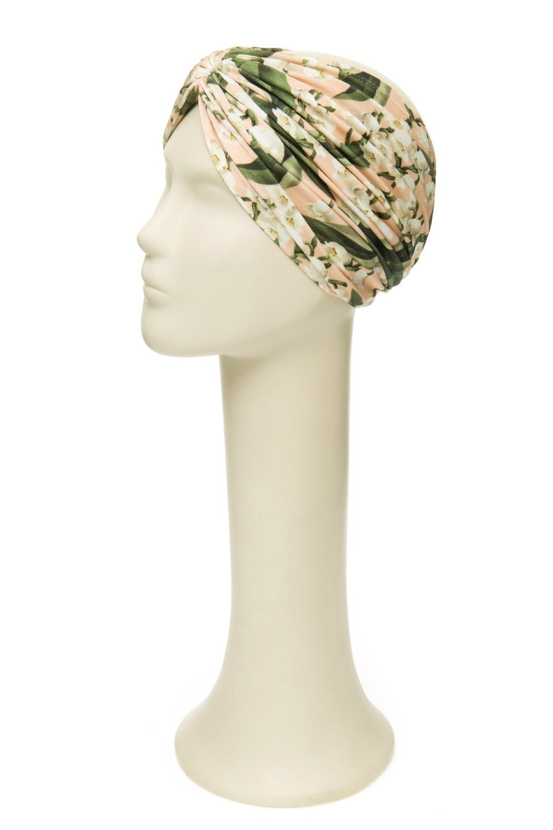 The headband is a vintage inspired accessorieand can be worn with a matching swimsuit poolside. We also love it with a coordinating dress after the beach