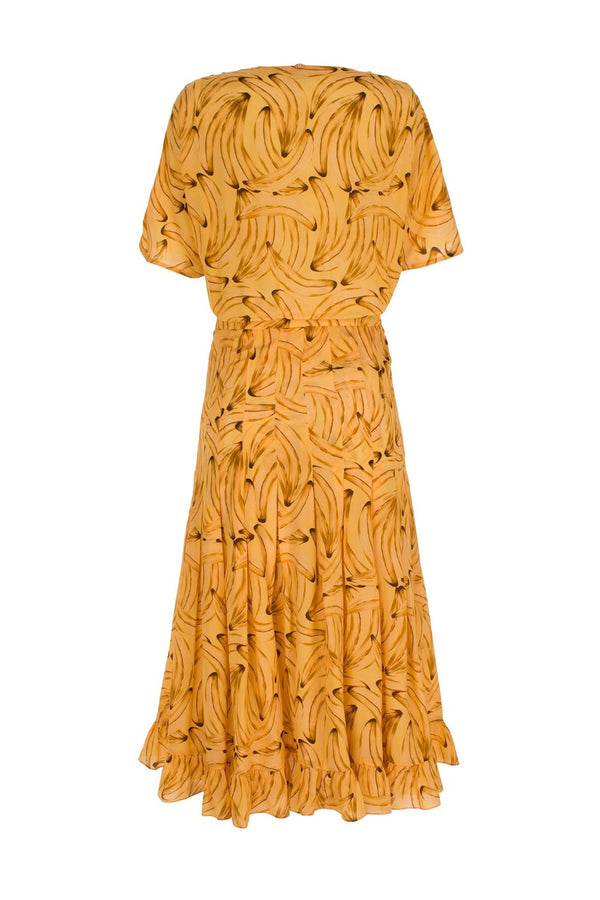 This banana print silk dress offers a refined interpretation of Adriana Degreas' Brazilian-inspired aesthetic