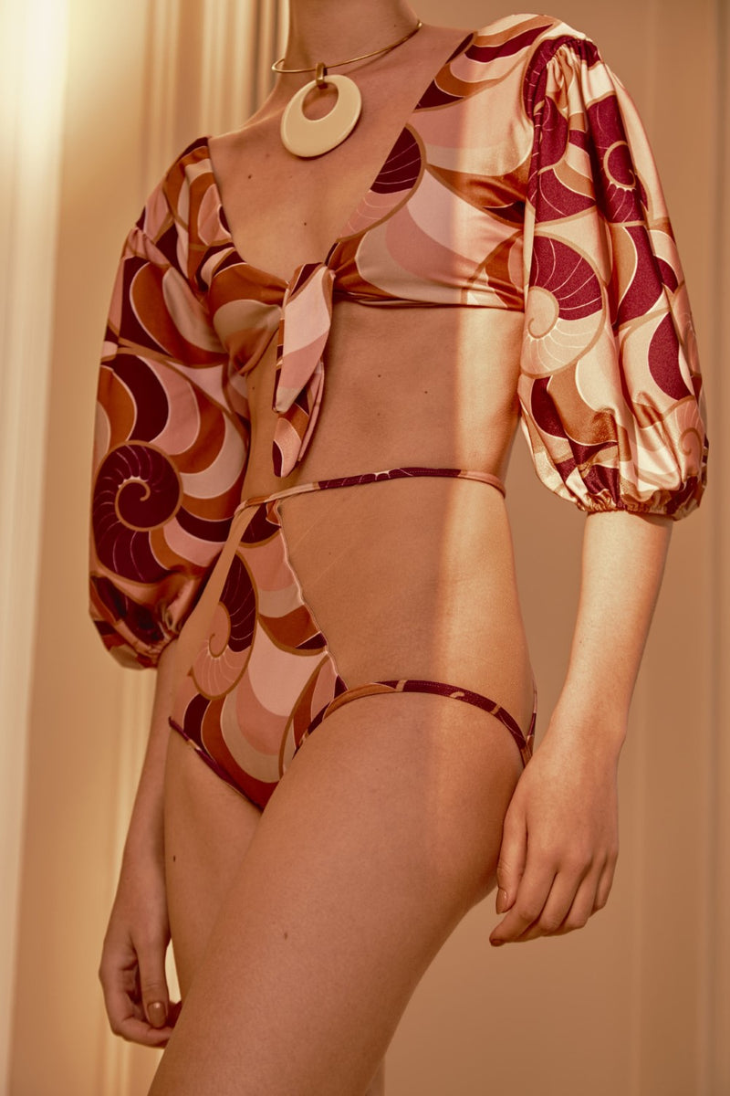 This vintage-inspired Nautilus printed bikini with blouson sleeves is a stylish way to dress for the beach or pool
