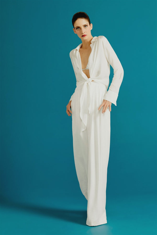 Adriana Degreas has an elegant approach to beach wear with key pieces like this wide leg silhouette silk pants