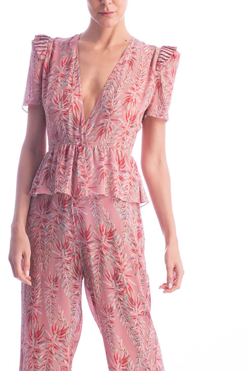 This long jumpsuit with deep V-neck is and elegant option for summer evenings- it´s made of silk and with wide-legs that create the illusion of a longer silhouette. Wear it with sandals for an elegant occasion