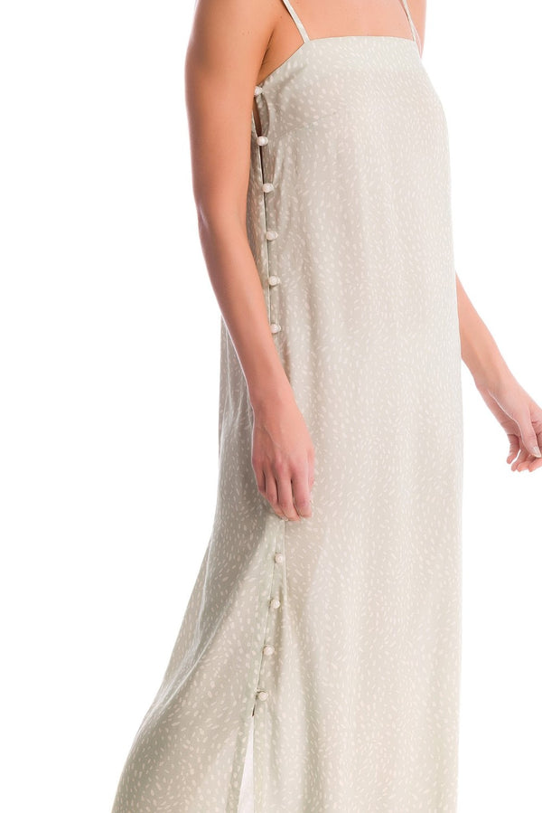 This long dress is shaped for a relaxed fit with a square neckline and side buttons. We love it with strappy sandals for alfresco dinner