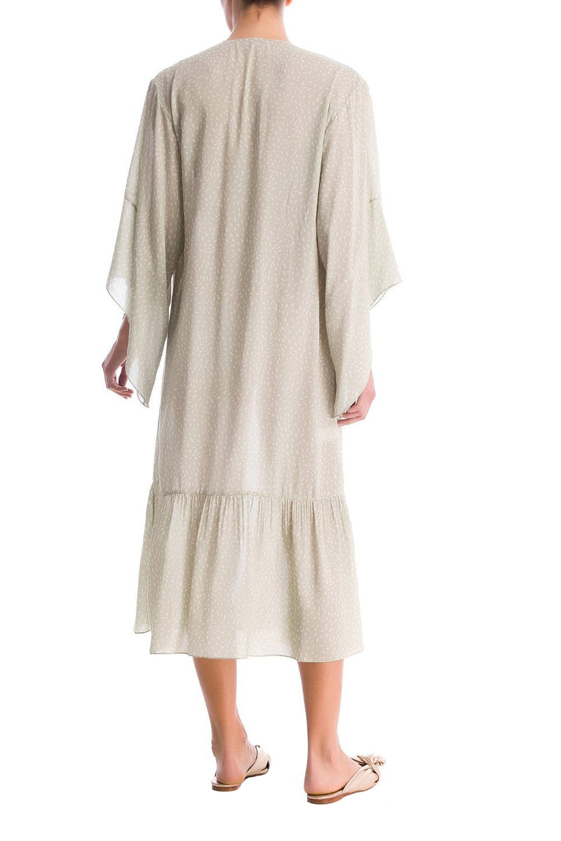 This long dress is shaped for a relaxed fit with a square neckline and side buttons