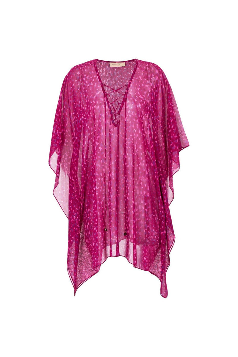 This short kaftan in vibrant color palette is perfect for summer vacations - just think how beautifully the pink and lilac hues will complement a golden tan