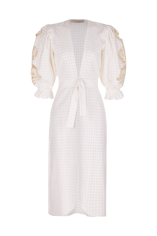 This robe was made to be worn on an exotic getaway, but will look equally elegant in the city
