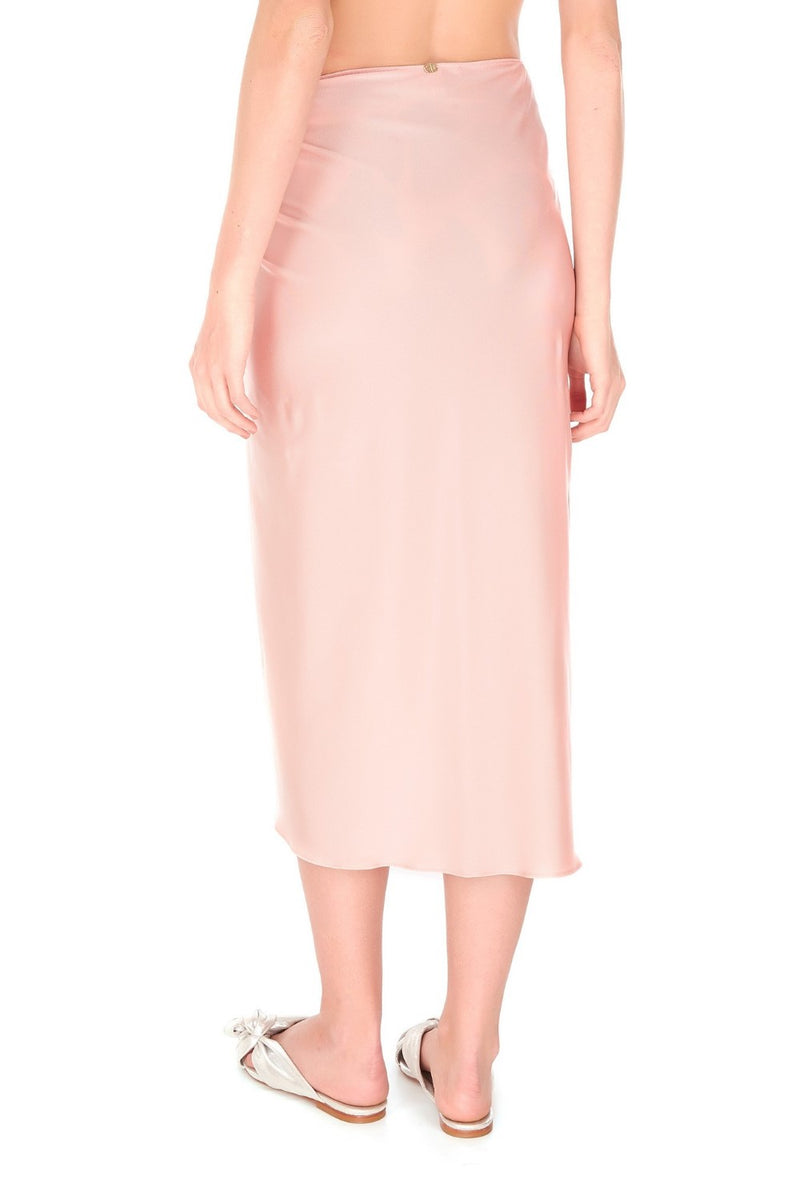 This pareo skirt is very practical and elegant. Cut from stretch fabric, you can simply knot it around your waist