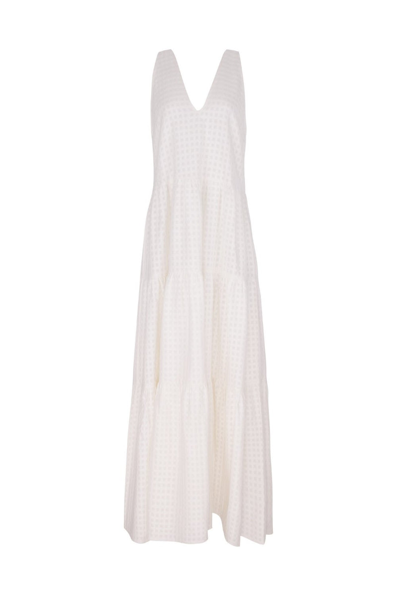 This timeless and romantic dress is crafted from cotton with an elegant V-neck and moves gracefully when you walk
