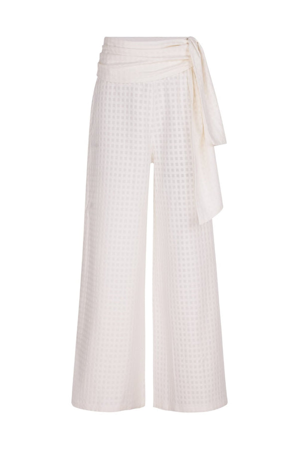 These cotton pants have an extra-long wide leg and can be worn on vacation with a matching shirt and slides for a contemporary outfit