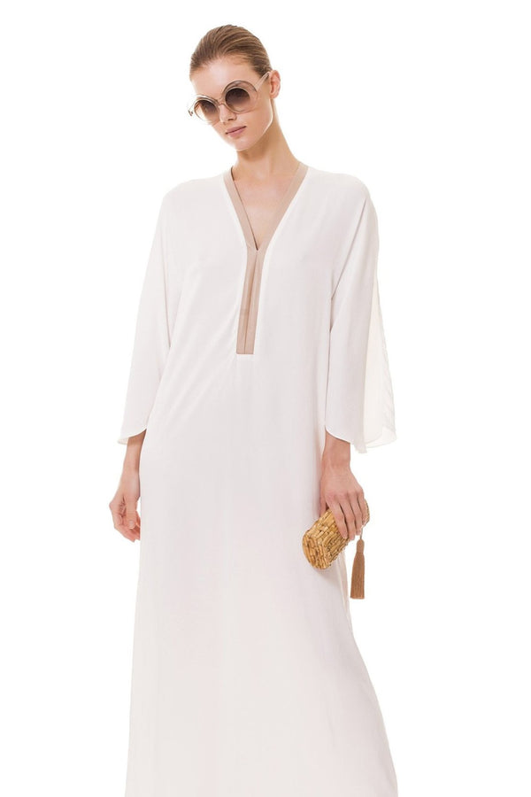 In plain white viscose, this long kaftan provides a light, yet bold look