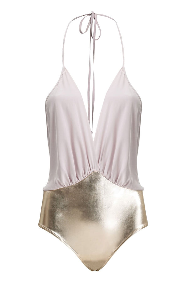 This effortless chic swimsuit is made of stretch fabric and silk- you can wear it as a bodysuit with wide-leg pants or with a matching skirt poolside for drinks with friends. We love with coordinating cover up for sunset parties at the beach