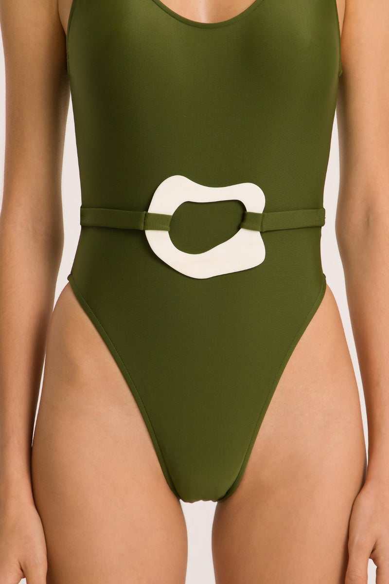 This modern meets vintage style swimsuit with i high cut leg is made in brazil and  crafted from  stretch fabric with acrylic buckle detail