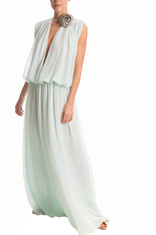 Inspired by movie stars from Hollywood, this elegant long dress is made of silk and shaped with a deep V neck