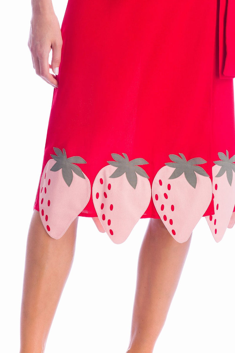 This self-tie midi skirt has hand-applied strawberry all over its hem. We love it with a macthing top for an evening out
