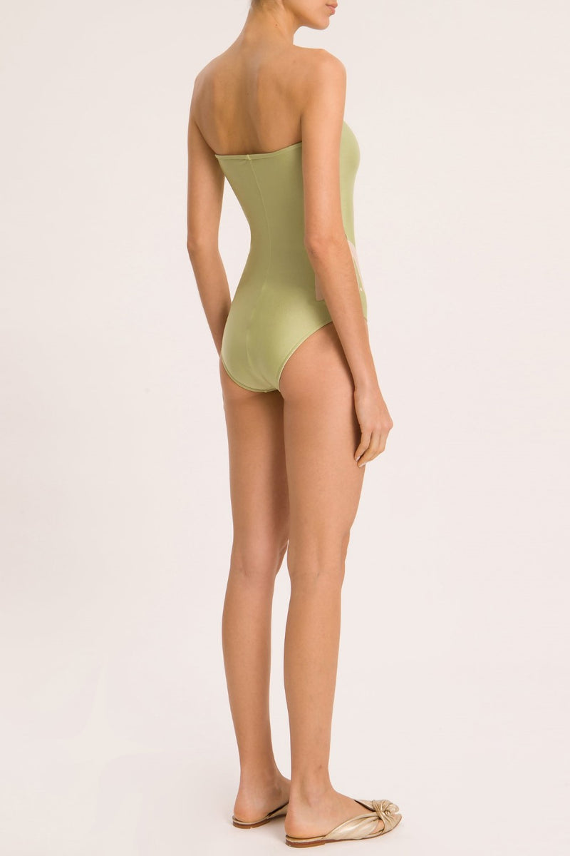 Think about effortless chic swimwear to wear day and night like this strapless swimsuit with flower applications