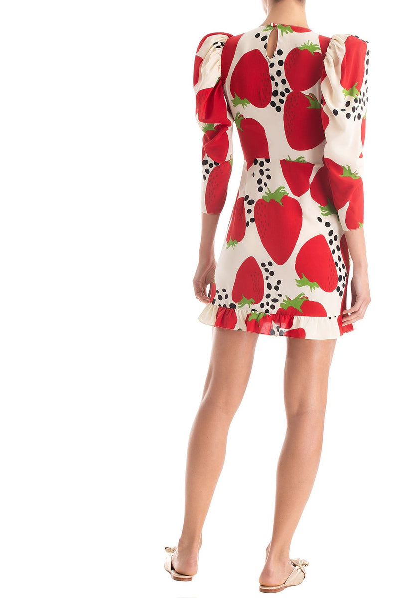 With a vintage inspired touch, this Strawberry dress is crafted with silk and  is shaped with exaggerated sleeves
