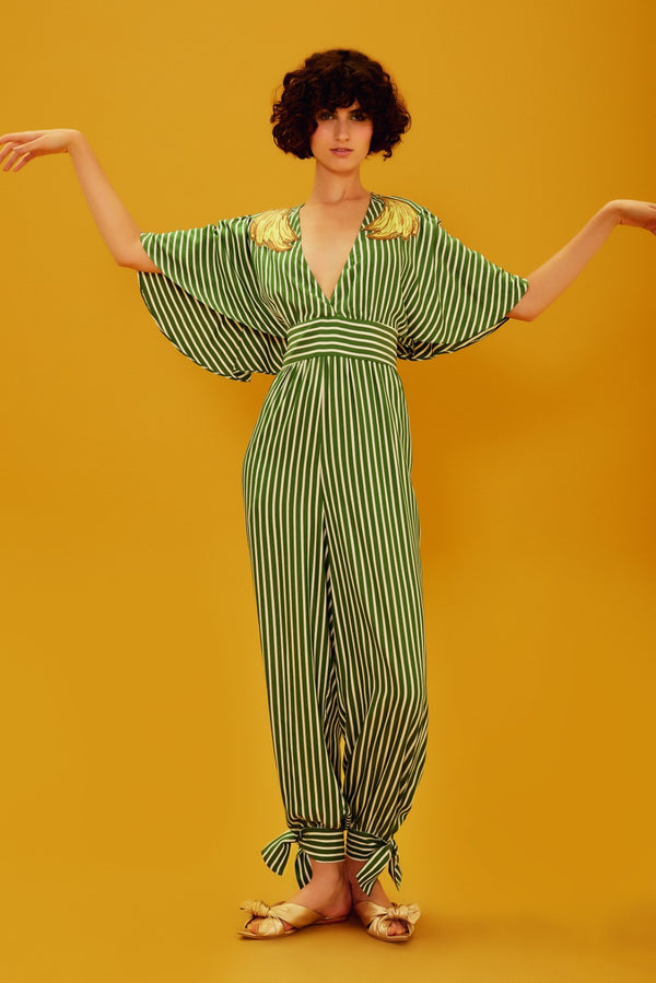 This striped jumpsuit has a playful banana appliqué detail, v-neck and loose sleeves. We love it with metallic flat sandals and a basket bag for drinks by the poolside