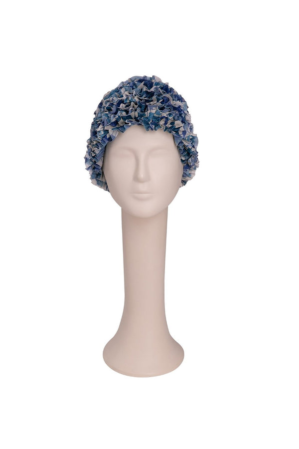 Capture the vintage mood of the collection with the patterned tulle ruffle cap.Wear it poolside