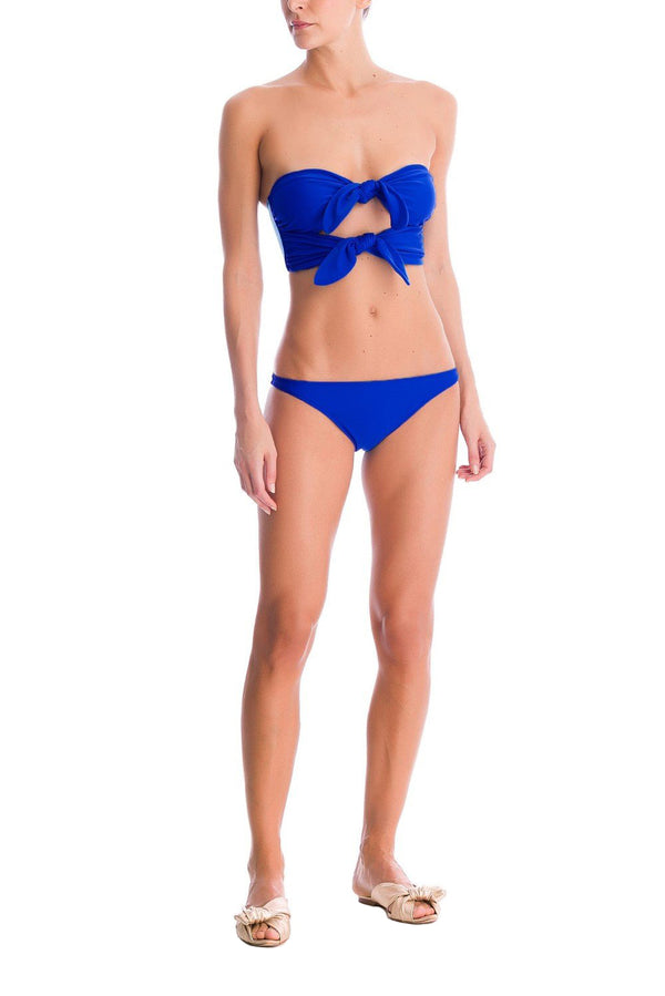 This blue bikini has a contemporary feel with vintage influences - featuring double front laces. Combine it with a cover up and a seaside basket bag