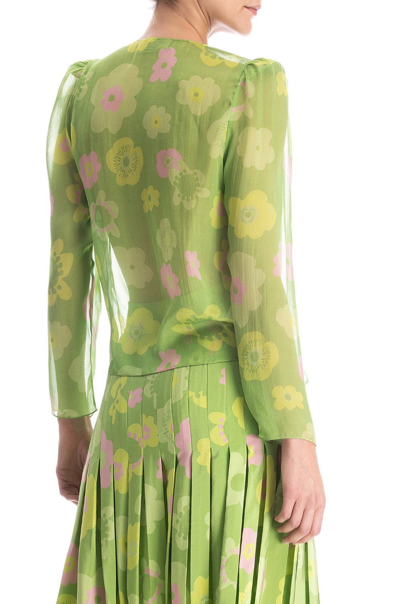 The Vintage Flower silk shirt is shaped with a deep V-neck, puff shoulders and waist ties for a flexible fit.