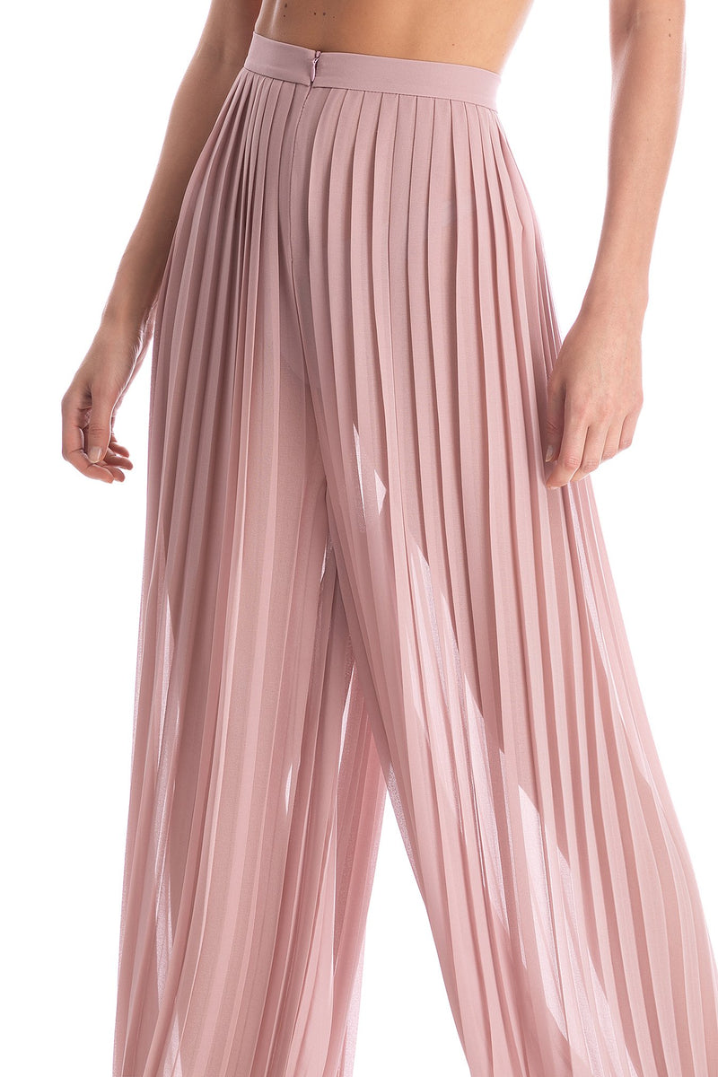 Look for irreverent and sophisticated pieces like these pleated pants made from lightweight fabric for your next evening out.